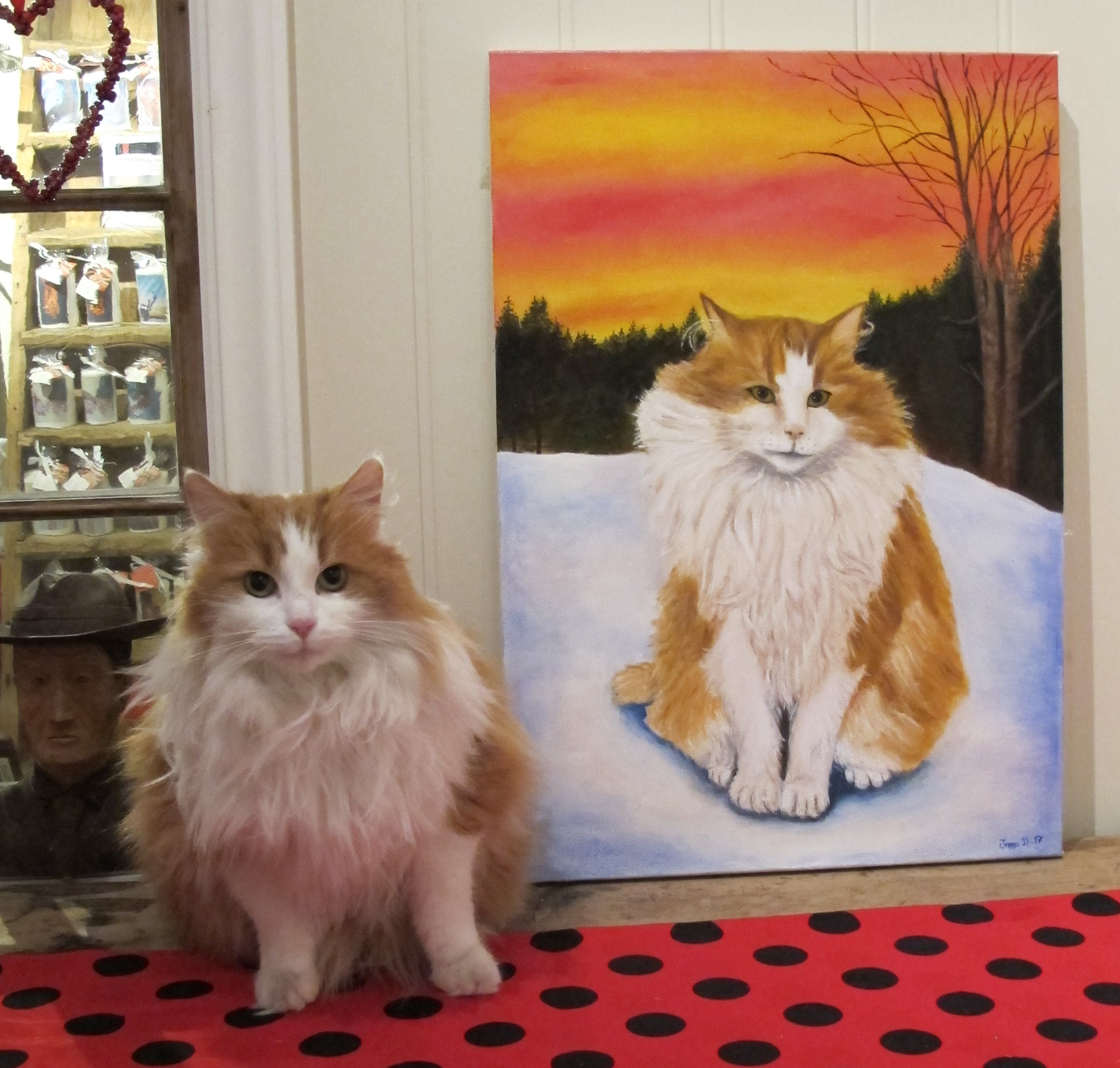 The cat Pusur visited to check on his portrait